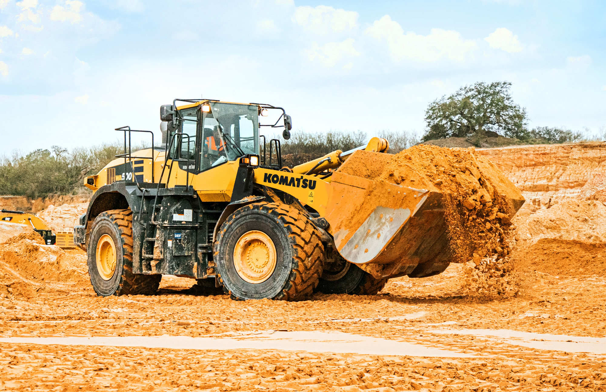 Madden Materials Tractor in Sand Quarry